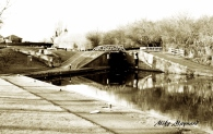 little bridge and locks in sepia